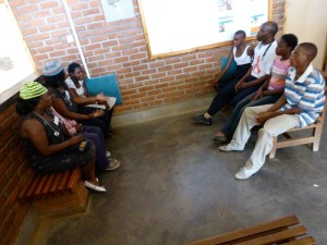 Adolescents discussing issues important to their health, with doctors and nurses at Dignitas International's Teen Club. Photo Credit: Edith Kachingwe.