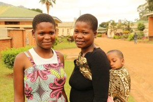 Linda pictured with her daughters Esther (left) and Chisomo.