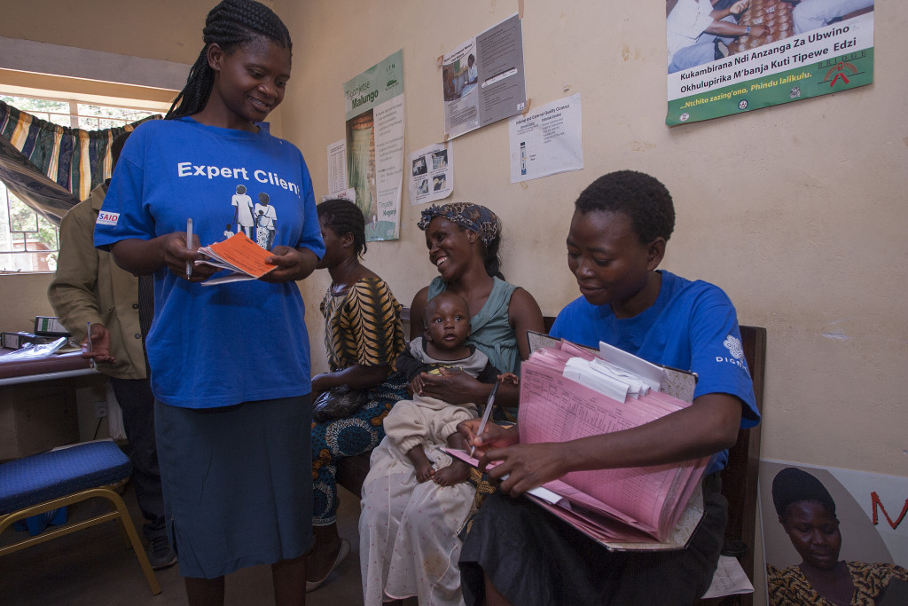 Dignitas International Expert Clients Monica Mpando, left, and Tereza Chikakuda centre, serve patients at Zomba City Clinic September 29, 2015. Dignitas International is a medical and research organisation dedicated to transforming patient health and health care systems for the most vulnerable people. PHOTO DIGNITAS INTERNATIONAL/AMOS GUMULIRA