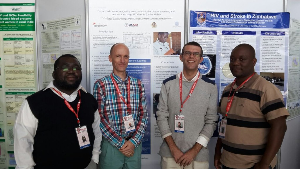 "(L-R) Dignitas staff members and study participants Dr. Wongani Nyangulu, Dr. Joep Van Oosterhout, Dr. Colin Pfaff and Aunex Kwekwesa in front of the featured research poster ""Early experiences of integrating non-communicable disease screening and treatment in a large ART clinic in Zomba, Malawi""."