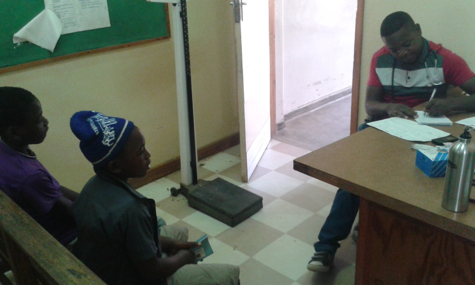 Victor, his twin brother, and Malawian Clinical Officer Trevor Dindi in the diabetes clinic.