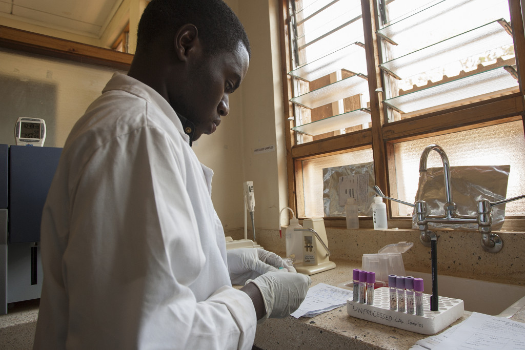 Laboratory Technician Vitumbiko Kalua working on samples to test them for CD4 Count at the Zomba Central Hospital Laboratory. The hospital houses Dignitas International's Tisungane Clinic. © Dignitas International / Amos Gumulira