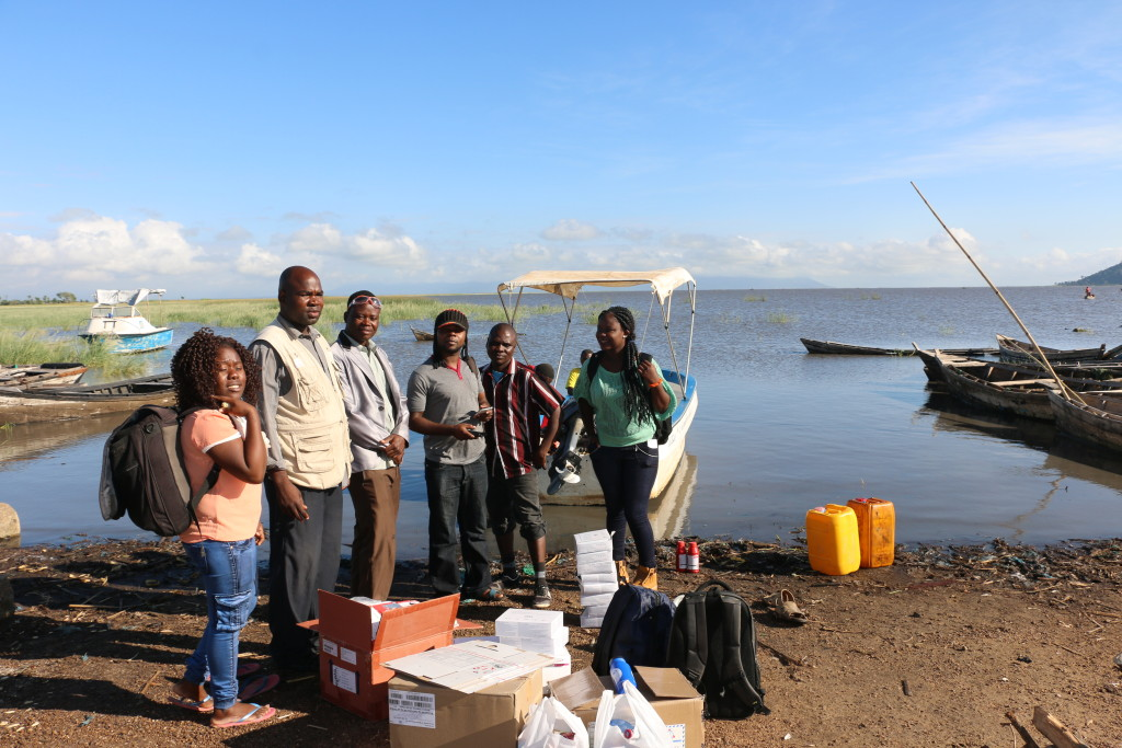 Delivering health services to a small island in Malawi's Lake Chirwa is both adventurous and tricky. George Mulewa (3rd from the right) leads a team to Chisi Island, where they will conduct HIV tests for all of the island's residents, including harder to reach individuals such as sex workers and fishermen. Those found HIV+ start on treatment immediately.