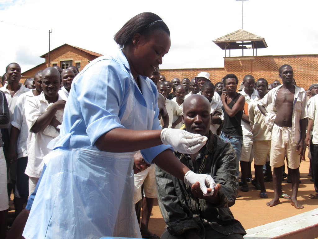 Inmates at Zomba Central Prison line up for regular HIV screening.